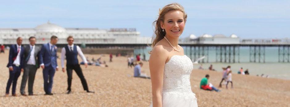 Bride posing on the beach near Brighton pier
