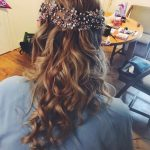 photo of close up og blonde curls for the back of prom queens head with flowers attached
