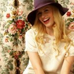 hoto form vintage fashion shoot, blonde in hat smiling