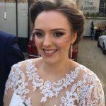 photo of brunette bride, close up smiling, lace dress